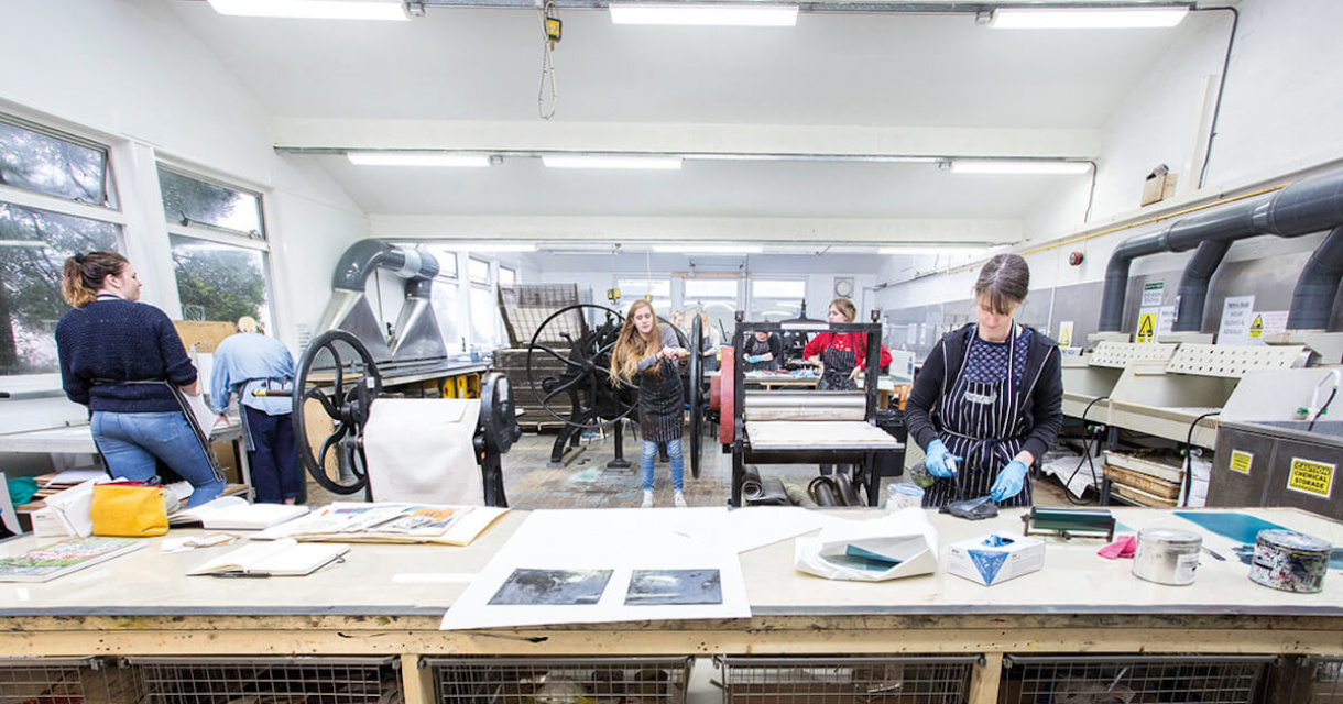 Students working in the printmaking studio on Falmouth University campus