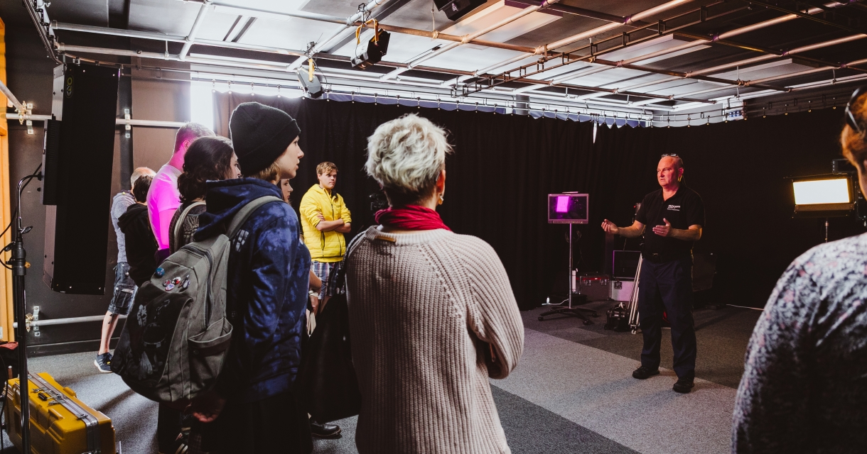 Falmouth staff giving talk to open day participants in the television studio.