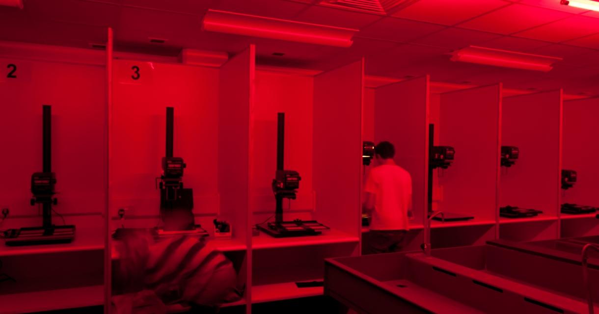 Red lit photography darkroom.