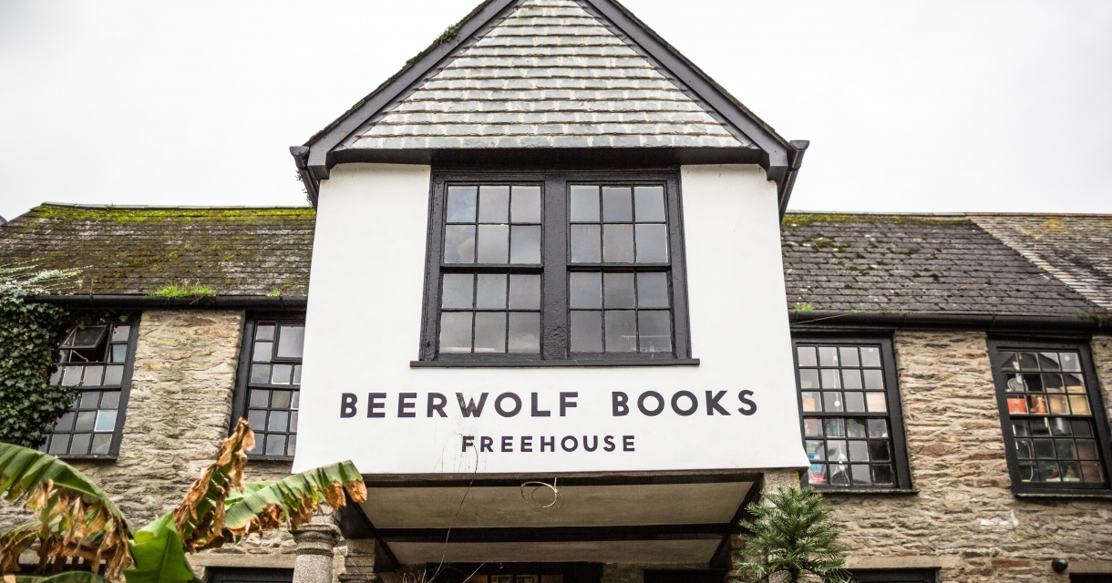 Close up of an old building with beerwolf books written on the front