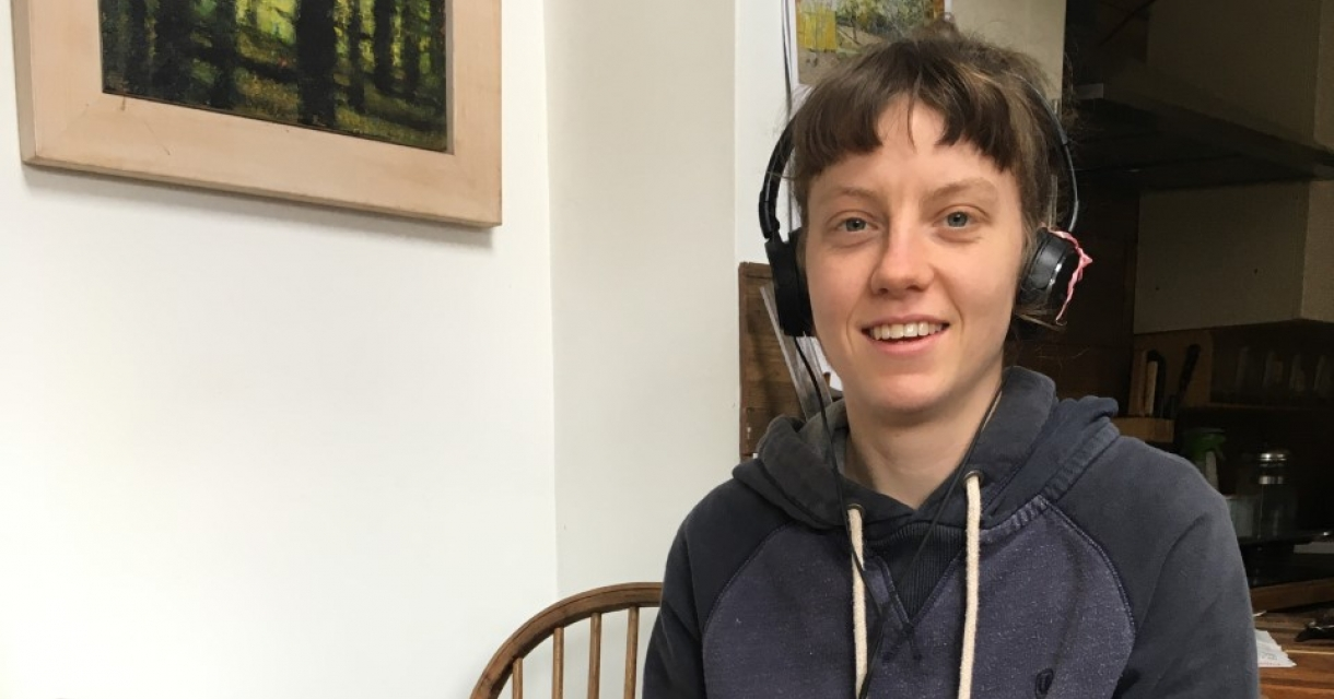 student records her contribution for the first radio show from her dining table at home