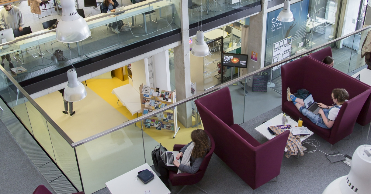 Open plan study area on multiple floors with purple chairs