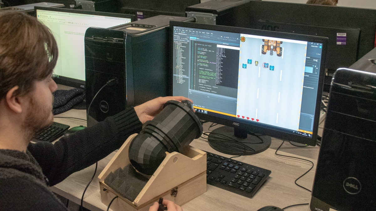 Games student using cannon controller