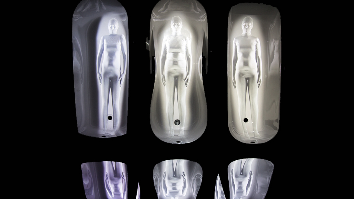 Image of illuminated figures in shiny suits.