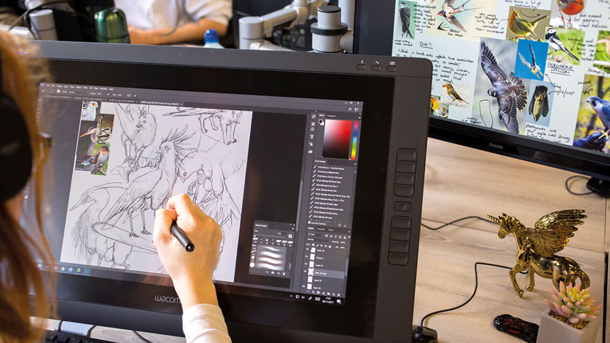 A Game Art student drawing birds on a digital screen