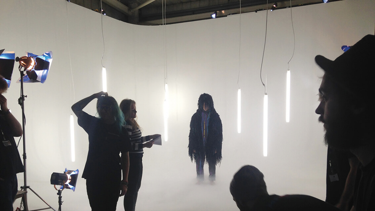 Film and TV students shooting a figure in a studio