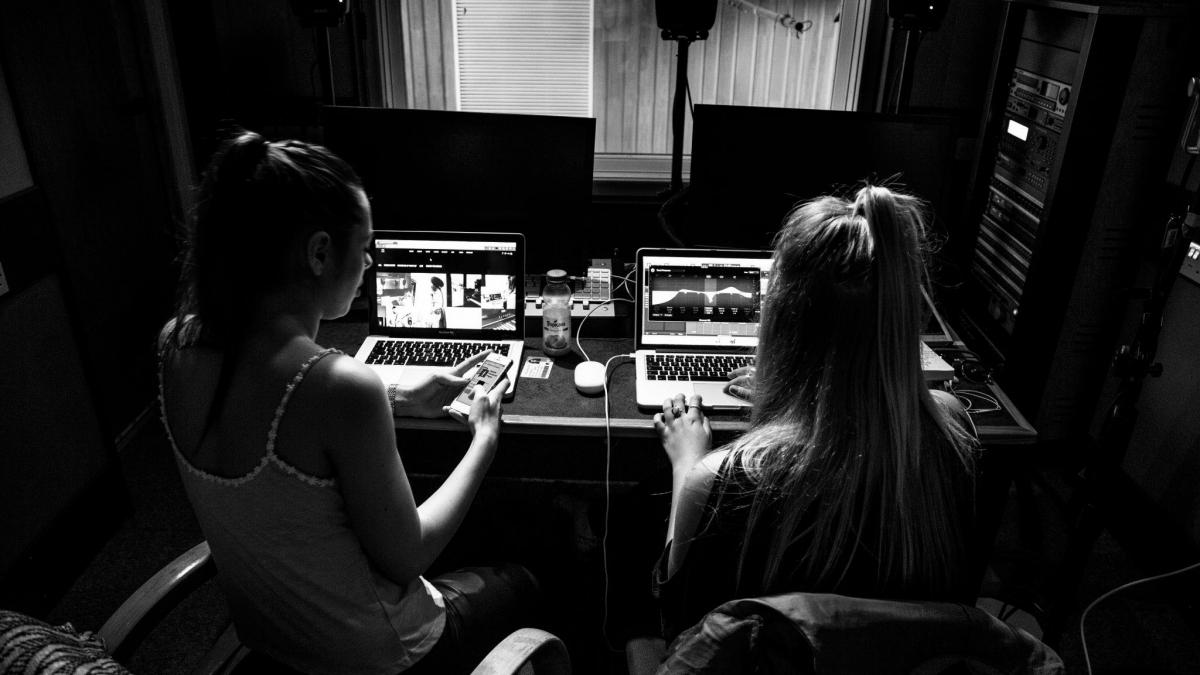 Student working a music studio at AMATA