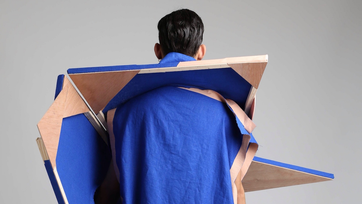 A figure in a blue robe with angles
