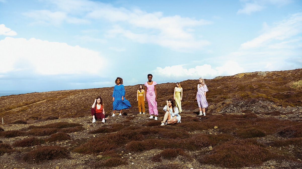 A group of Popular Music students posting on a barren landscape
