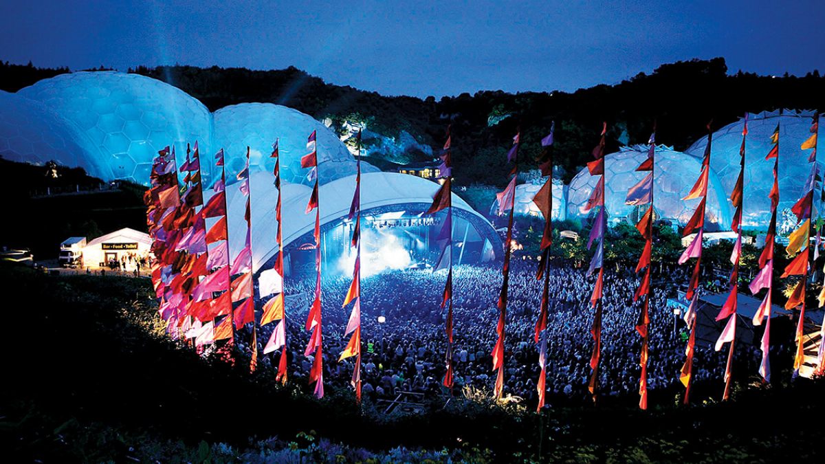 Music festival at the Eden Project with domes and pink flags