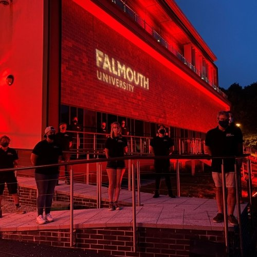 Falmouth University AMATA building shines red in support of #WeMakeEvents