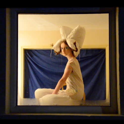 Graduate Gemma Worral poses in white dress