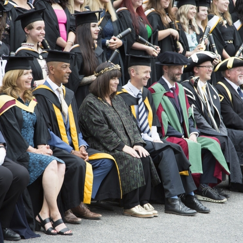 Staff, students and Dawn French at graduation