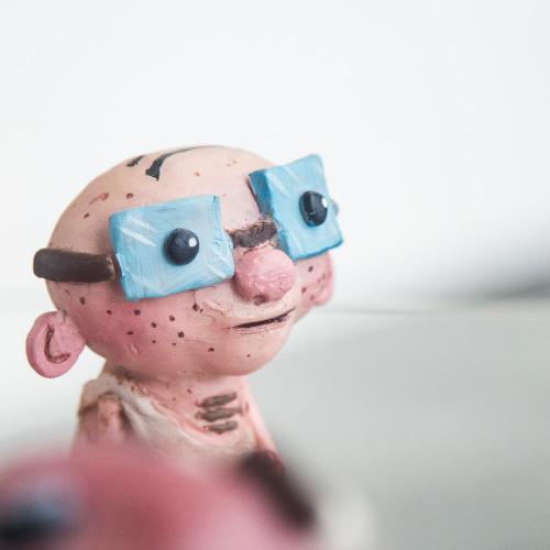 Animation BA(Hons) model of a bald man wearing large blue glasses