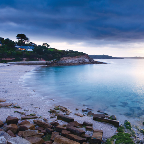 View of Swanpool beach at dusk