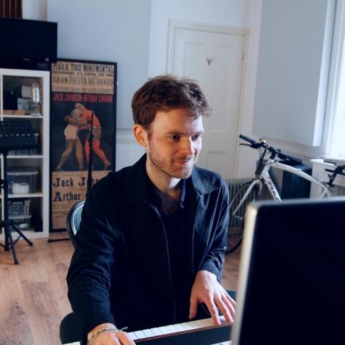 Graduate, Joe Donohoe, on the piano