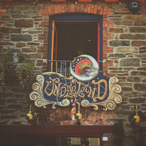 The circus-inspired sign hanging over bar and venue Underland in Falmouth