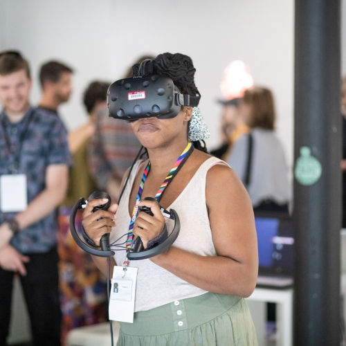 Lady using Virtual Reality equipment