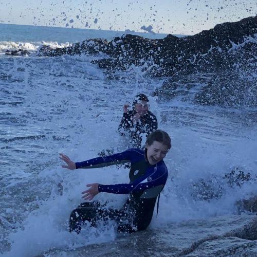 Two friends splash around in white water