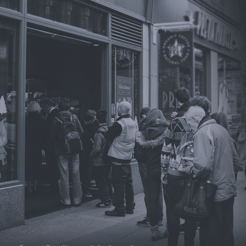 A queue of people outside Greggs bakery