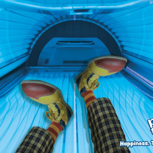 Clown feet in a tanning bed