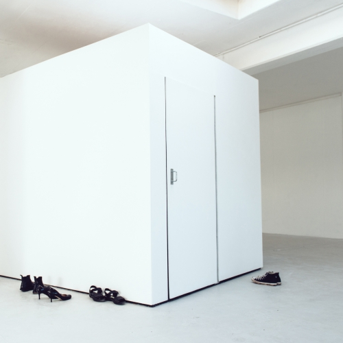 A large white cube with door