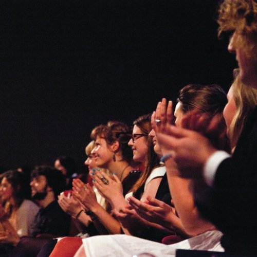 An audience clapping.