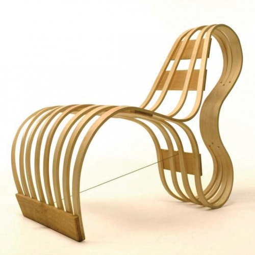 Steam bent wood curved lounger chair.