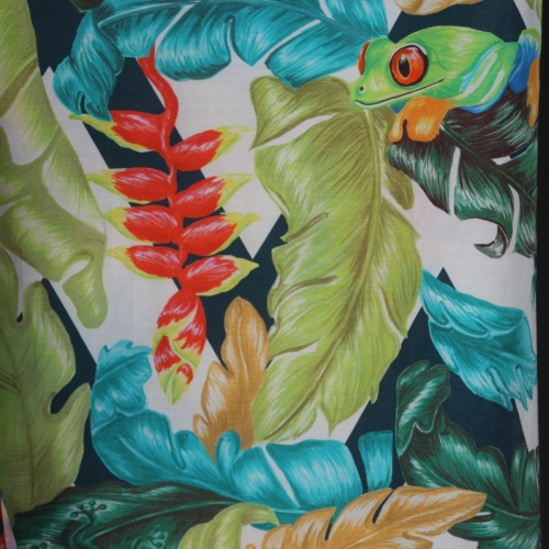 Tropical printed fabric with a red eyed frog.