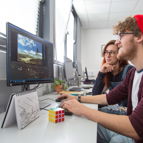 Animation students creating a landscape on a computer