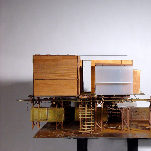 3D architectural model of a building on stilts