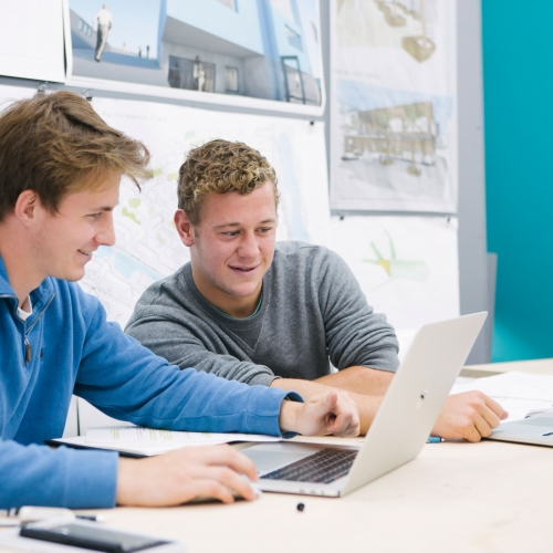 Architecture students working together at computers