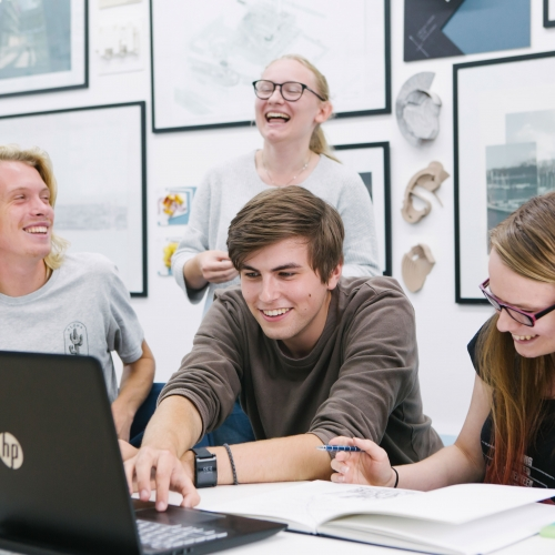 Architecture students working together and laughing