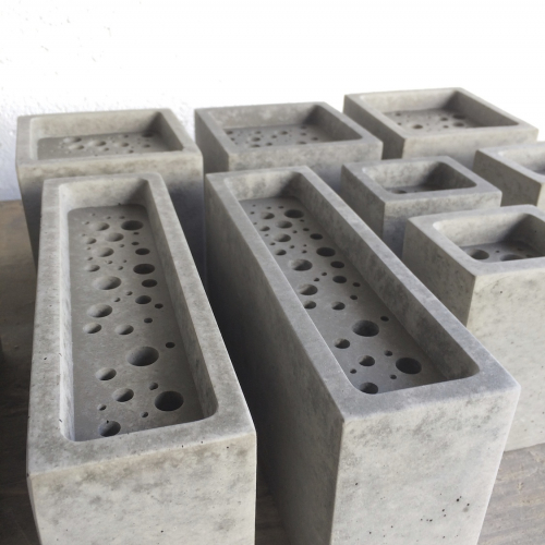 A group of Bee Bricks in grey