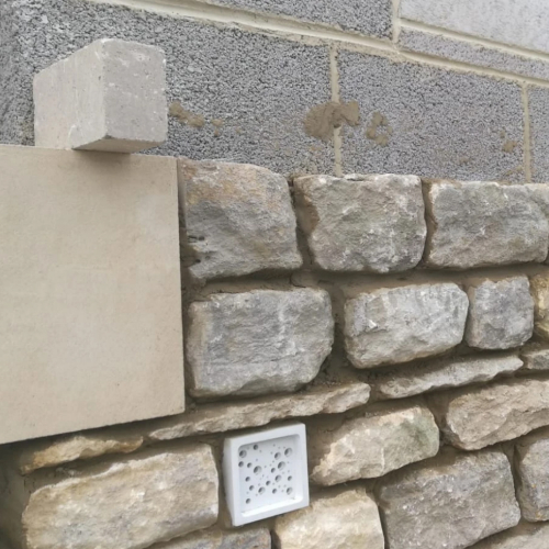 A stone wall being built with Bee Bricks
