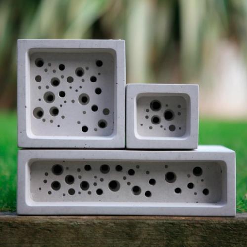 Three white Bee Bricks stacked