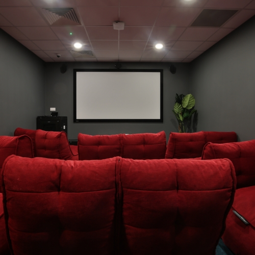 Cinema interior with large red seats
