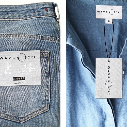 Detail of label on jeans back pocket and neck of denim shirt.