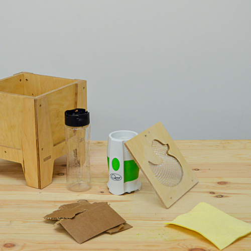Wooden box with duck panel and a plastic bottle