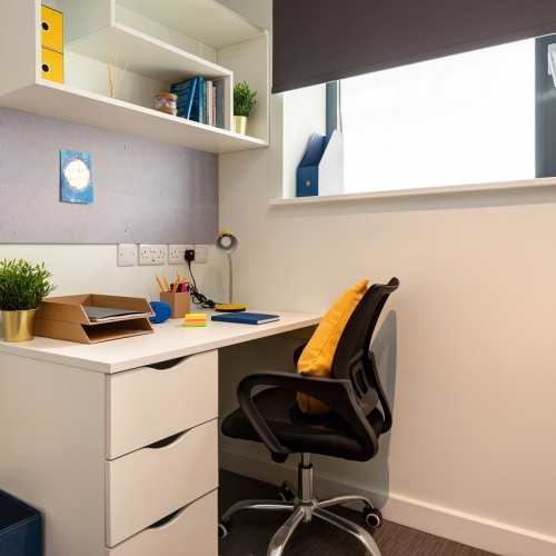 White desk and chair in a student room