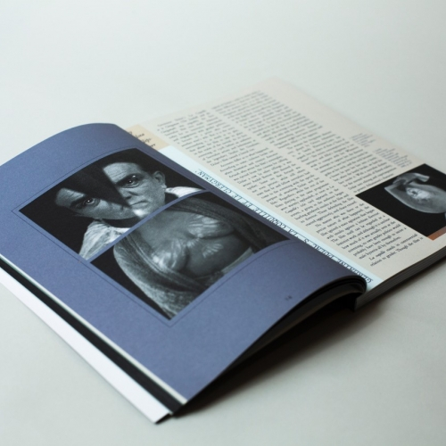 Journal open, blue page with monochrome photography.