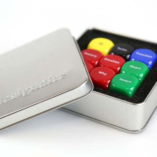 square metal silver box with multicoloured dice