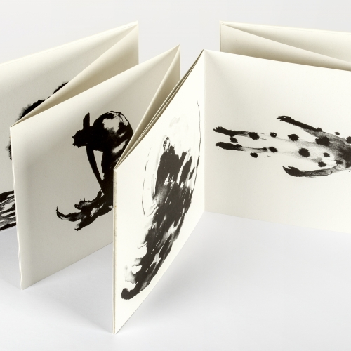 black and white drawings on folded paper