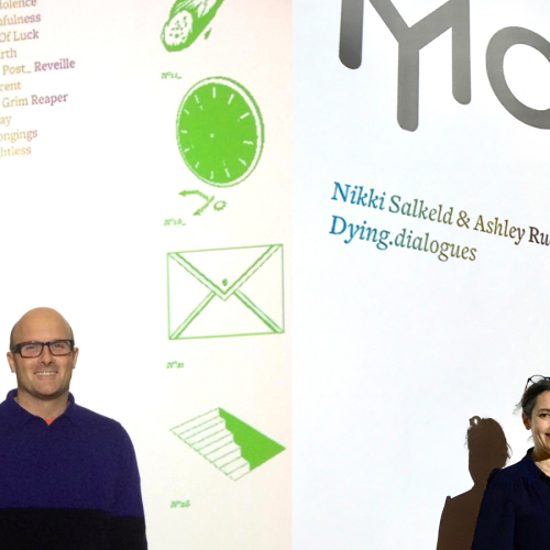 Two people stood in front of Moth branded posters