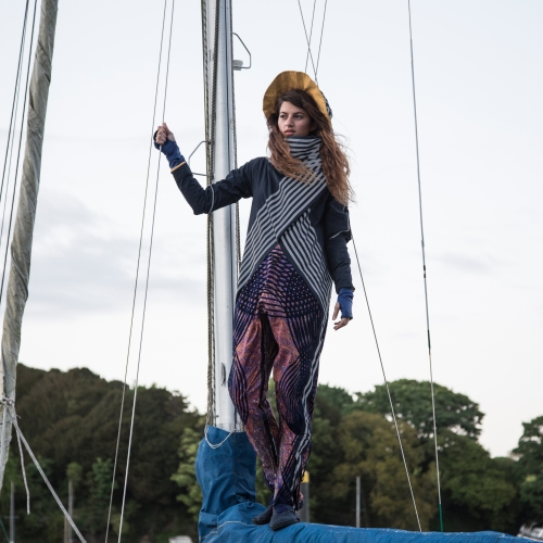 Model stood on mast wearing crossover striped top.