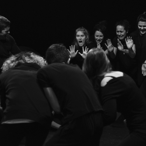 Falmouth University Acting students performing with hands raised