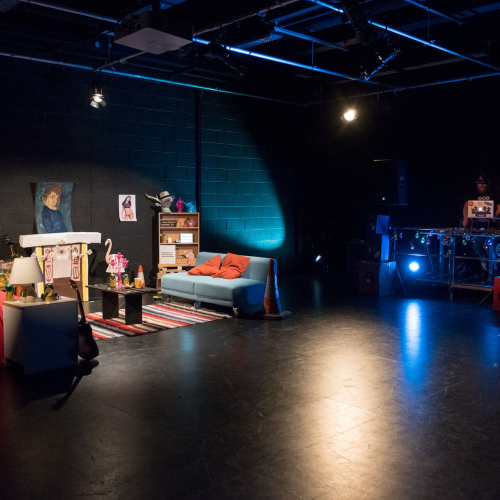 A film set featuring a living room set up.