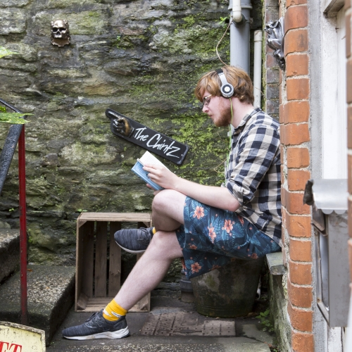 Student reading in Falmouth town