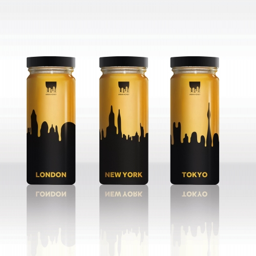 Gold and black honey jars with rounded skyline of cities.