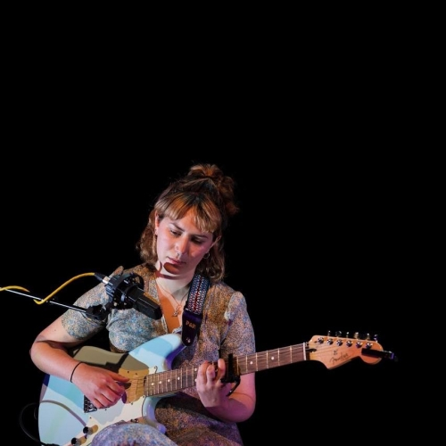 student on guitar